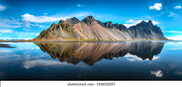 Splendid sunny day and gorgeous reflection of Vestrahorn mountaine on Stokksnes cape in Iceland. Location: Stokksnes cape, Vestrahorn (Batman Mount), Iceland, Europe.