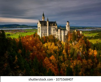Splendid sunset scene on Neuschwanstein Castle with colorful sky and autumn trees. Bavaria, Germany.