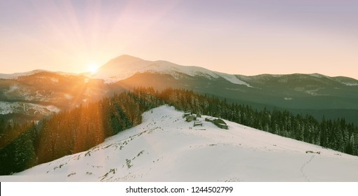 splendid winter landscape, picturesque evening scenery, wooden houses on the meadow on background Petros mountain, awesome nature image, Kukul range, Carpathians, Ukraine, Europe
