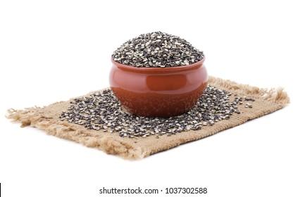 Split Black Lentil Also Know as Black Gram, Black Urad Dal, Vigna Mungo, Urad Bean, Urad Dal, Minapa Pappu, Mungo Bean or Black Matpe Bean Isolated on White Background