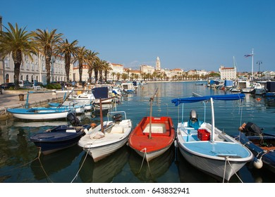 Split city's harbor with colorful boats and the Diocletian Palace in the background