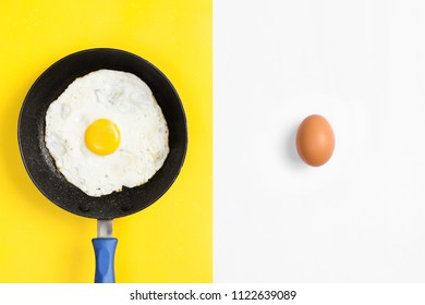 Split color flat lay image with cooked and uncooked egg.