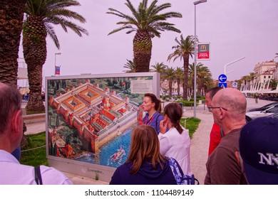 SPLIT, CROATIA - APR 15, 2018 - Tour guide explaining map of  Roman Emperor Diocletian's Palace, Split, Croatia