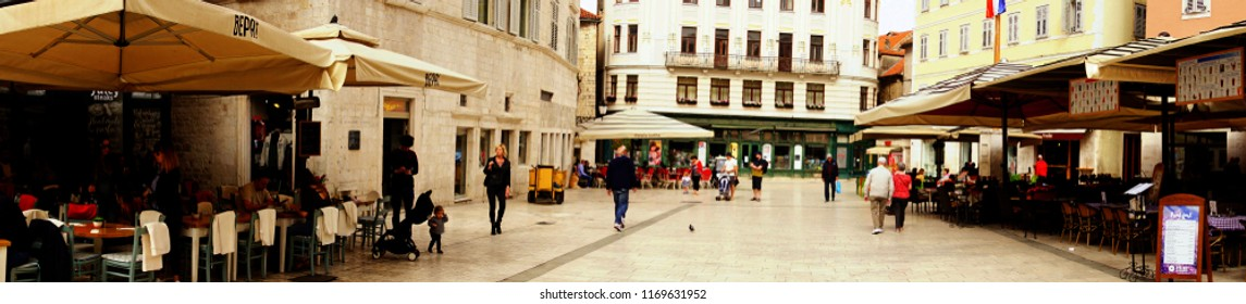 SPLIT, CROATIA - APR 15, 2018 - Diners at an outdoor restaurant in Split, Croatia