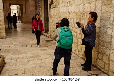 SPLIT, CROATIA - APR 15, 2018 - Tourists taking pictures of each other in Diocletian's Palace, Split, Croatia