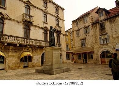 SPLIT, CROATIA - APR 15, 2018 - Statue of Marko Marulic, Croatian poet and humanist, Radica Square in old town of Split, Croatia
