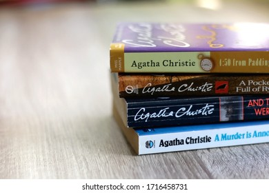 Split, Croatia- April 26, 2020: Stack of Agatha Christie's crime and mystery novels on a table. Selective focus.