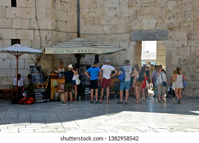 Split, Croatia - August 11, 2018 : tourists  buying some drink in a outdor caffè in the old town of Split