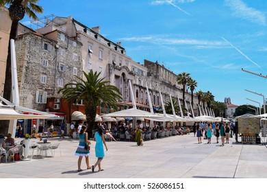 SPLIT, CROATIA - CIRCA JUNE 2015: Unidentified people walk along the Riva Promenade outside the Old Town of Split
