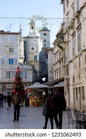 Split, Croatia - December 12, 2014: People enjoying Christmas atmosphere and decorations on People's Square in Split, Croatia.