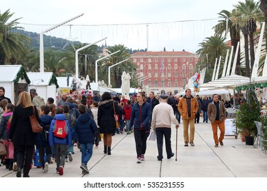 Split, Croatia - December 2, 2016: Bunch of people enjoying nice winter day and Christmas atmosphere on Riva Promenade in Split, Croatia. During Advent Riva becomes place for Christmas Fair.