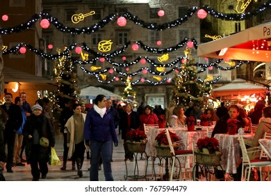 Split, Croatia - December 2, 2016: Visitors enjoying Christmas atmosphere at People's Square in Split, Croatia during evening.