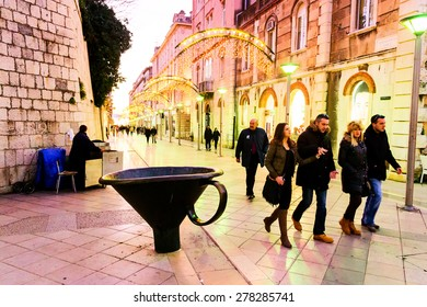 SPLIT, CROATIA - JANUARY 1: Tourists and citizens walking along one of the main streets in the old town of Split, Croatia on January 1, 2012.