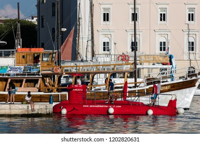 Split, Croatia, July 24, 2018: Semi-submarine Marijeta in the Split harbor. It remains above sea level at all times, while its hull, the underwater observatory stays 5 feet below the surface.