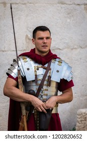 Split, Croatia, July 24, 2018: Man dressed up as a Roman legionnaire near ancient Roman Diocletian's Palace in Split, Croatia.