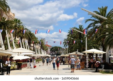 Split, Croatia - June 24, 2019: Locals and tourists enjoying sunny summer day on Riva promenade in Split, Croatia.