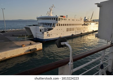 "SPLIT / CROATIA - JUNE 28 2012: Jadrolinija car ferry ""Valun"", length 81.2 meters and width 15.1 meters, at port in Split harbor, from deck of ""Liburnija""."