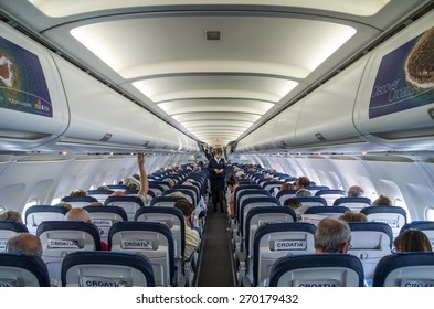 SPLIT, CROATIA - MARCH 6, 2015: Passengers inside of Croatia Airlines' Airbus A320 during pre-flight safety demonstration.
