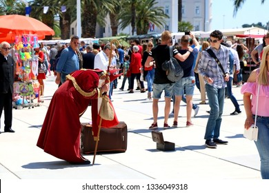 Split, Croatia - May 7, 2016: Crowd celebrating Saint Domnius Day (Sudamja) on Riva promenade in Split, Croatia. Man dressed as Saint Domnius for charity. Saint Domnius is the patron saint of Split.