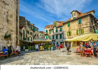 Split, Croatia - October 1 2017: Tourists enjoy cafes and shops on an early autumn afternoon on the Fruit Square in the Diocletian's Palace section of Old Town Split, Croatia.