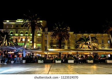 Split, Croatia - October 1 2017: Tourists and local enjoy a late night at the Riva Promenade at the harbor of Split Croatia on the Dalmation Coast