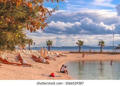Split / Croatia - September 19, 2016: Famous croatian beach called Kasuni Beach (Croatian: Plaa Kasjuni), by the Adriatic Sea, in Split, Croatia.