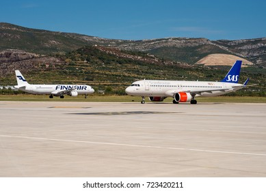 SPLIT / CROATIA - SEPTEMBER 2017 Finnair Airbus A321-211, OH-LZD in the take off roll on runway 05 while SAS Airbus A320-251N(WL) starting to taxi towards the runway.