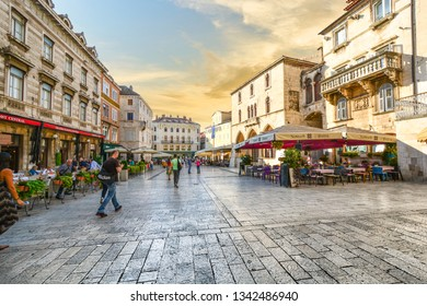 Split, Croatia - September 28 2018: Morning at the People's Square inside the Diocletian's Palace area of Old Town Split, Croatia as tourists and locals start the day