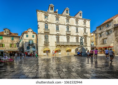 Split, Croatia - September 29 2017: Visitors pass through Trg Brace Radic or the Fruit Square with it's shops and outdoor restaurants on a sunny summer day in Split Croatia