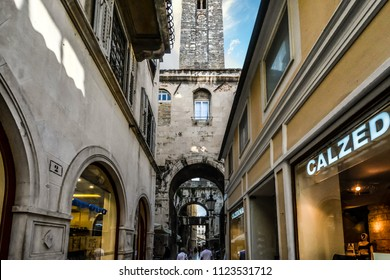 Split, Croatia - September 29 2017: Tourists walk past shops and stores, through tunnels and under medieval towers in the Diocletian's Palace section of the ancient city of Split, Croatia