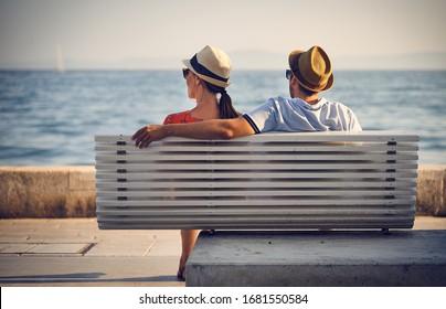 SPLIT, CROATIA-JULY 5,2019: A couple in love enjoying the serene beauty of the ocean on a summer evening in Split, Croatia