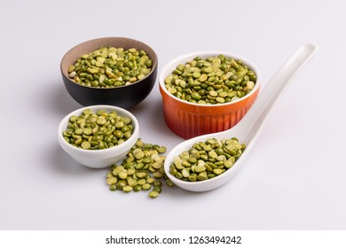 Split dried uncooked peas in several ceramic bowl, isolated on white background, close-up, studio shot, soft light. Christmas dish