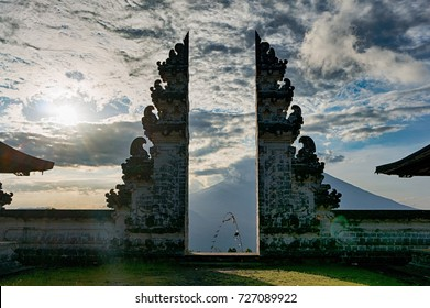 Split gateway wich is called candi bentar in the acient balinese temple Pura Luhur Lempuyang, with stratovolcano Gunung Agung on the background, Bali, Indonesia
