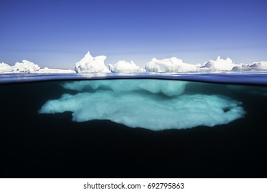 Split image showing what is happening above and below the waterline at the ice floe edge during a sunny day in Lancaster Sound, Baffin Island, Canadian Arctic.