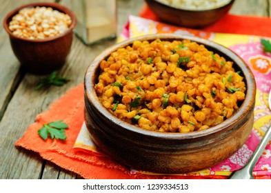 Split peas dal in a bowl on a wood background. toning. selective focus