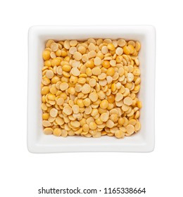 Split pigeon peas in a square bowl isolated on white background