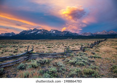 a split rail fence, pasture and meadow, and the Sawtooth Mountains near Stanley, Idaho.