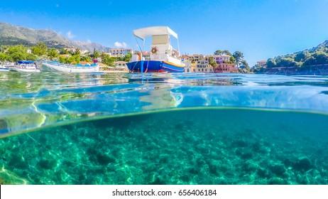 split shot boats in greece island harbour