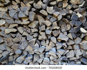 Split and stacked firewood.