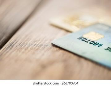 Split toned macro image of credit cards up close