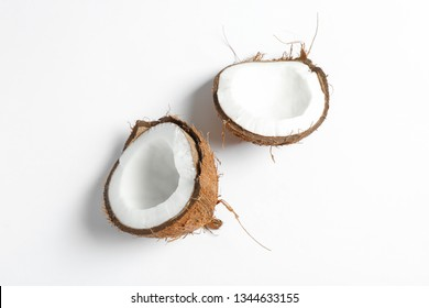 Split tropical coconut isolated on white background