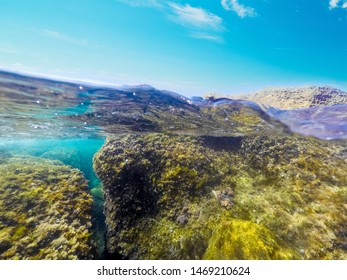 Split uderwater view of Sardinia clear water, Italy