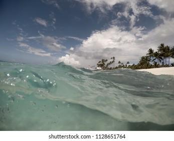 Split view half and half of choppy waves and sea underwater at Matautu, Lefaga, Upolu Island, Western Samoa, South Pacific