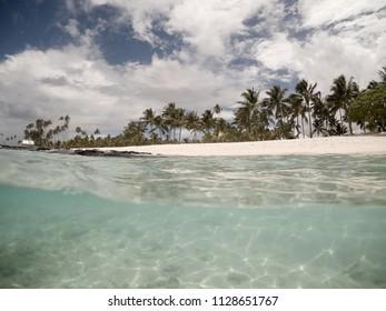 Split view half and half of clear sea underwater and beach at Matautu, Lefaga, Upolu Island, Western Samoa, South Pacific