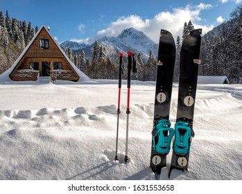 Splitboard and poles in snow at winter landscape background with mountain peak . Sport equipment for ski touring