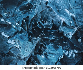 Splits in ice. Сool background. Ice cracks. Rock texture. Ice texture. Rough structure mineral. Stone background.