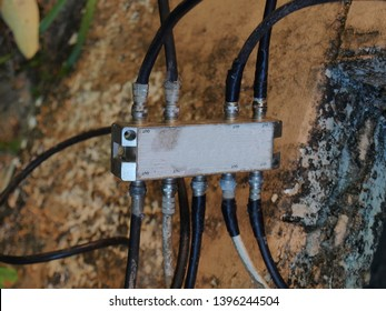 Splitter for connecting coaxial TV cable, 2 Way TV Splitter Signal Cable TV (CATV & MATV) Analog and Digital Satellite isolated on white background with clipping path.On a blurred tree background