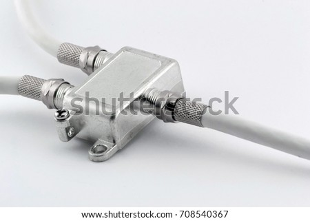 Splitter for connecting coaxial TV cable on white background