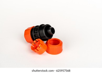 Splitter garden hose gray and orange, on white background. Used to connect the hose when watering the garden