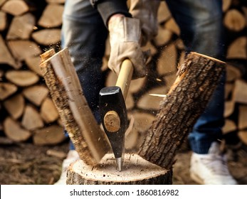 Splitting of a firewood with an ax, close up